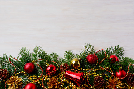 Christmas background with pinecone, golden and red ornaments. Christmas party decoration with shiny balls. Christmas greeting background. Copy space. 写真素材