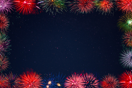 christmas in july: Amazing celebration multicolored sparkling fireworks frame.  4th of July beautiful fireworks. Independence Day, Christmas, New Year holidays salute. Stock Photo