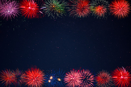 christmas in july: Frame of beautiful celebration golden, red, purple, green sparkling fireworks.  Independence Day, 4th of July holidays salute. Christmas, New Year beautiful fireworks. Holidays background.