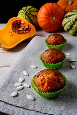 wrappers: Pumpkin muffins in the green wrappers with squash seeds. Fall seasonal homemade vegetable food.