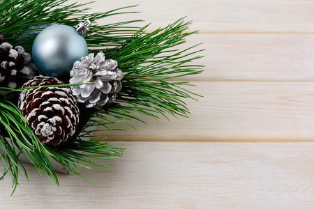 centerpiece: Christmas background with blue ornaments, silver and snowy pinecones. Christmas table decorated centerpiece. Copy space.