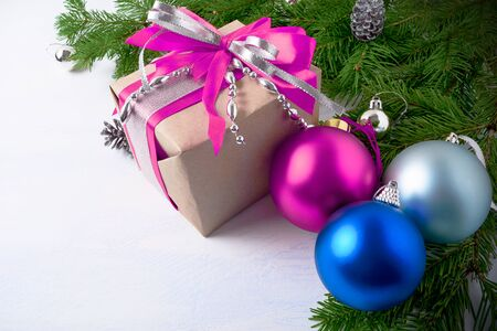 Christmas gift box with pink bow and silver ribbon. Christmas background with pink ornament. Stock Photo