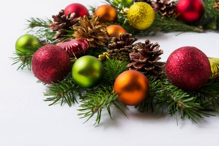 christmas tree branches with red green orange and yellow ornaments christmas decoration with - Orange Coloured Christmas Tree Decorations