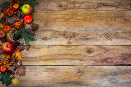 Rustic Thanksgiving Background With Pumpkin Apples And Cones On The Left Side Of Old Wooden