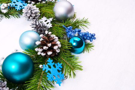Christmas wreath with felt snowflakes, silver, blue, turquoise baubles, fir branches and pine cones, copy space