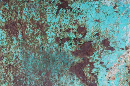 Weathered cracked blue paint and rusted metal background. Grunge texture template for overlay artwork.