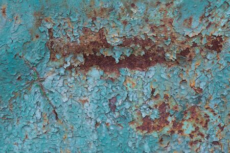 Old cracked blue paint and rusted metal background. Grunge texture template for overlay artwork.