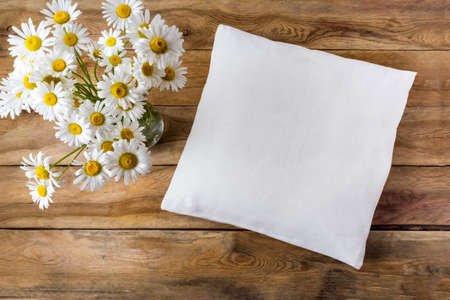 Square cotton pillow mockup with daisy wildflowers. Rustic linen pillowcase mock up for design presentation