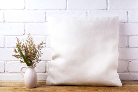 Square cotton pillow mockup with ravenna grass in the pitcher. Rustic linen pillowcase mock up for design presentation 版權商用圖片