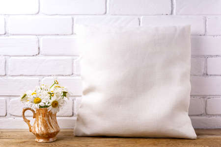 Square cotton pillow mockup with daisy bouquet in the golden vase. Rustic linen pillowcase mock up for design presentation 版權商用圖片