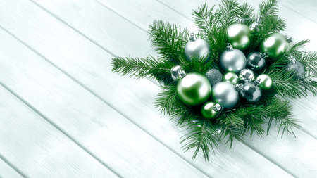 Christmas decorations with silver and green ornaments. Christmas party decoration with shiny balls. Christmas greeting background. Copy space.