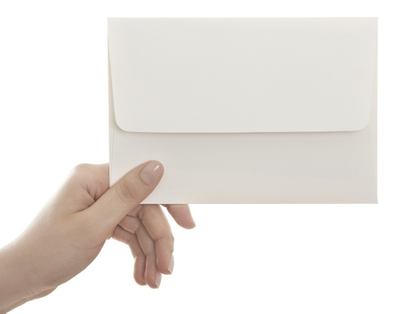 Woman handing an envelope isolated on a white background  photo