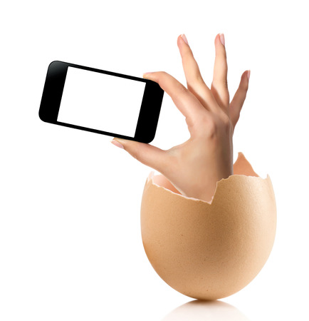 albumen: Hand with broken egg isolated on white backround. Hand of young man holding smart phone white screen isolated on white background with clipping path