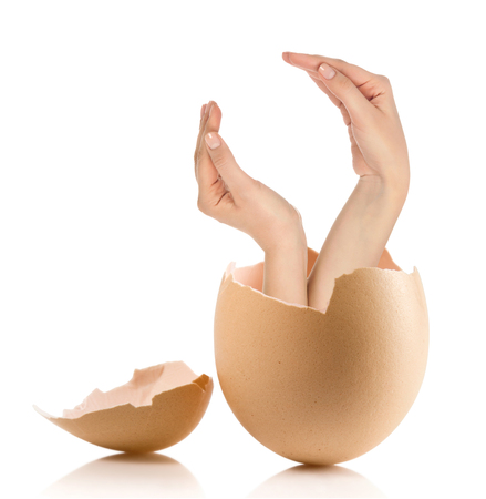 albumen: Hand with broken egg isolated on white backround Stock Photo