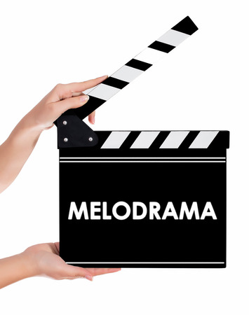 melodrama: Hands holding a clapper board.Isolated on white backround Stock Photo