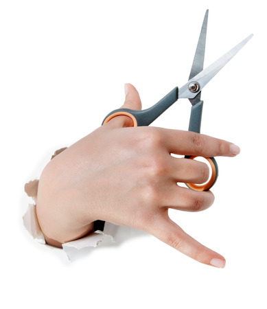 hand holding thinning scissors shear in hand isolated on white background. Stock Photo