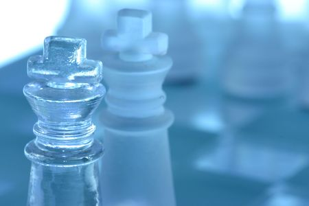 Closeup of two kings in a chess battle.