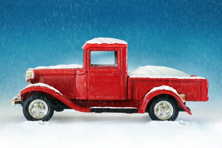 christmas red pickup truck on snow background