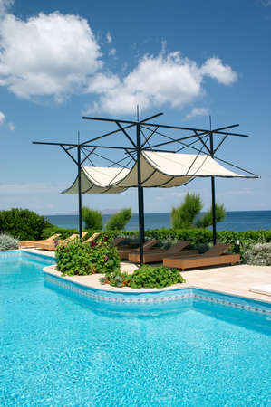 swimming pool on the seaside in resort