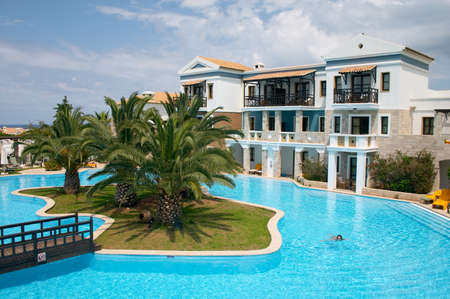 resort with swiming pool and palm tree