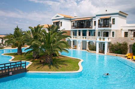 girl swimming in a pool in tropical resort
