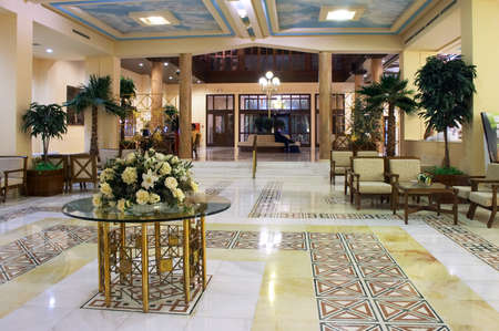 Hall in hotel with marble floor and flowers on the table Stock Photo - 1565261