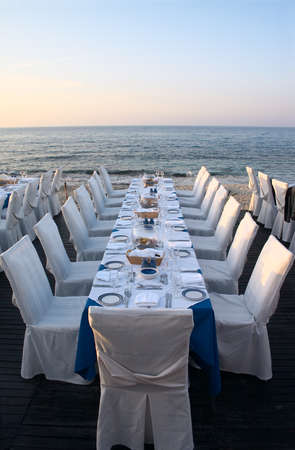 Restaurant tables served on the beach