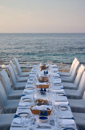 served table on the sea shore in resort Stock Photo