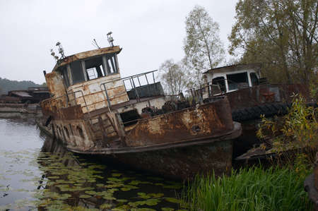 blasted: blasted rusty boat in the river near of Chernobyl