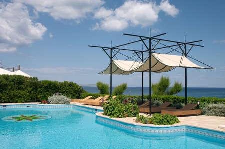 swimming pool in seaside resort Stock Photo