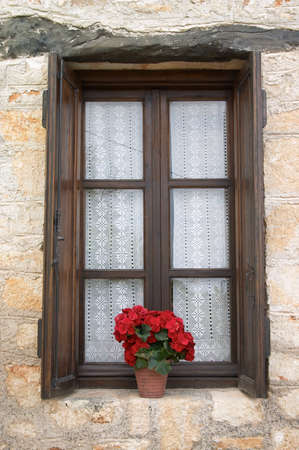 old window with flower pot Stock Photo