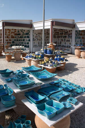 plates and bowls in ceramic shop in greece