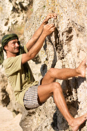 rock climber man is climbing a very steep rock Stock Photo - 1584013