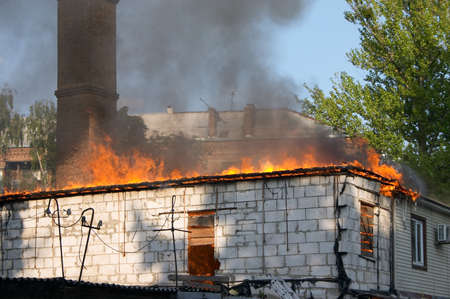 house flaming in fire