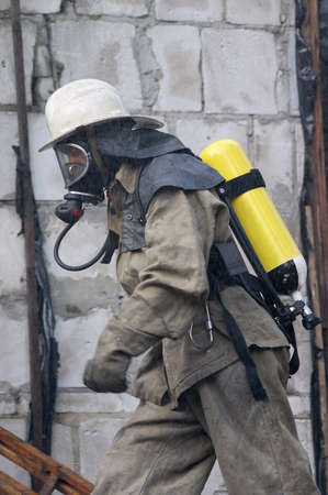 fireman in respirator going to a fire