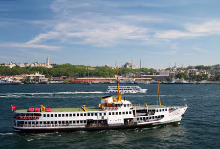 pleasure boat in Bosporus against a background of mosques