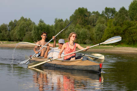 peoples travelling on canoe across the river
