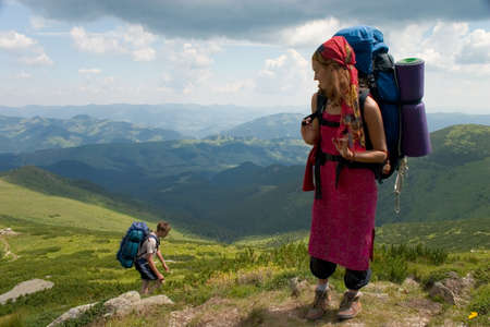 Couple of backpackers hiking in a mountain