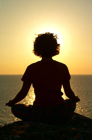 meditation above the sea in time of sunset