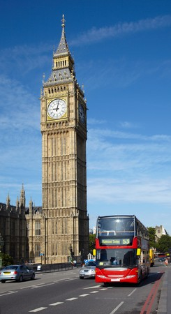 Double-decker bus near of Big Ben tower in London