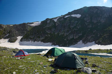 bivouac: Camp in the mountains near of the lake Stock Photo