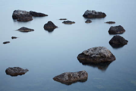 pacification: Stones in the tranquill sea water