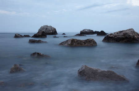 pacification: Rocks in th tranquill water Stock Photo