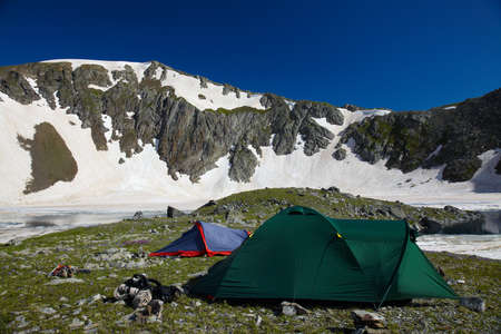 Bivvy wih tents  in the mountains near of he lake