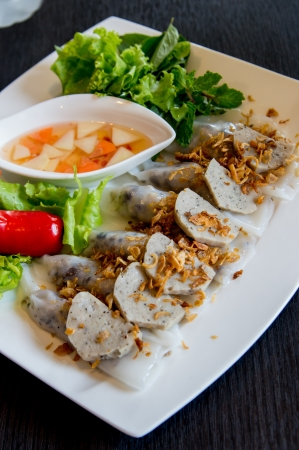 cuon: Vietnamese food  Banh Cuon  dish set on table, a rice noodle roll filled with seasoned ground pork Stock Photo