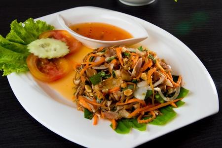 Vietnamese food spicy papaya salad dish set on the table
