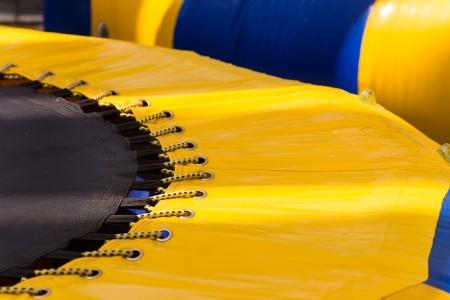 Part of yellow blue strip trampoline Reklamní fotografie