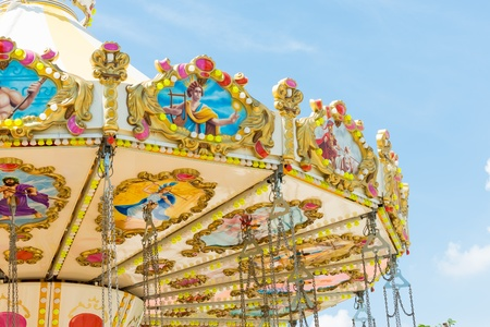 marry go round: top section of marry go round amusement park ride with clear blue sky Stock Photo