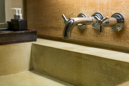 hot cold separated shiny metal water tap in bathroom photo