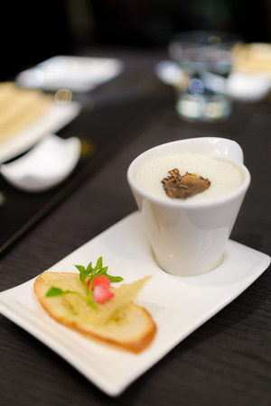 White truffle mushroom soup served with biscuit